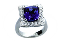 Cushion cut Tanzanite ring approximately 6.5ct with round brilliant diamonds set in Platinum